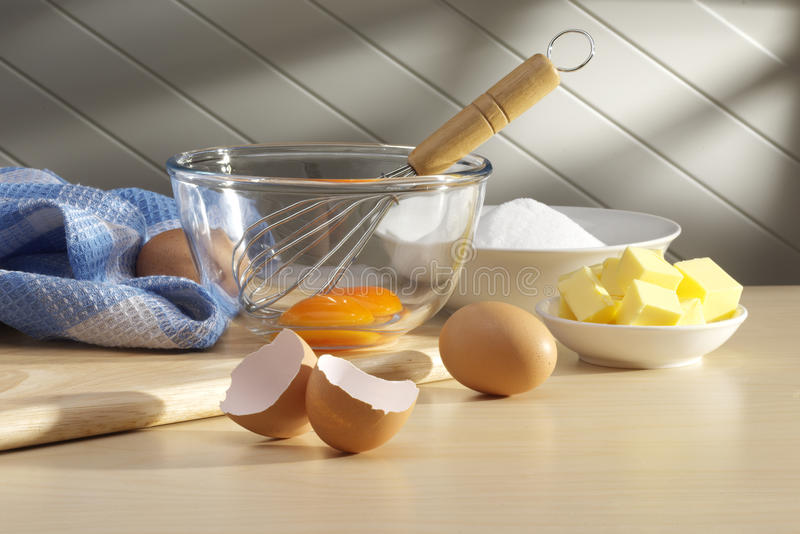 Baking Ingredients. Eggs, butter, sugar on kitchen bench ready for baking
