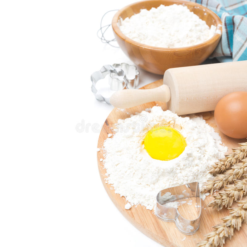 Baking ingredients - flour, egg and baking forms, isolated royalty free stock photos