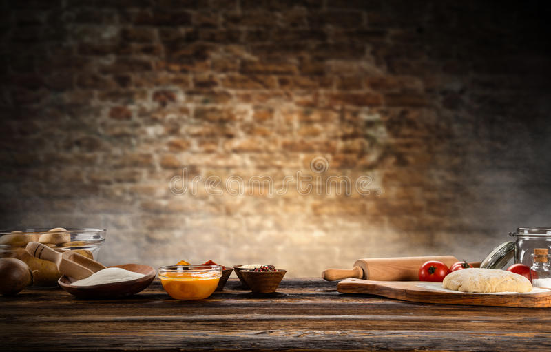 Baking ingredients placed on wooden table royalty free stock images