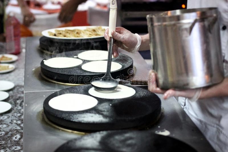 Pancakes, baking pancakes, the chef prepares, Breakfast at the restaurant, The cook fries the pancake on the plate, the cooking pr. Baking pancakes, the chef royalty free stock photo
