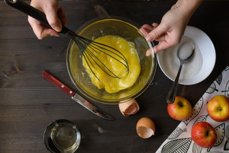 Baking pancakes in rural kitchen royalty free stock photos