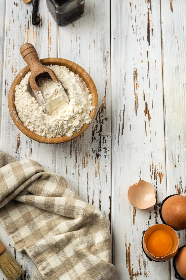 Baking pastry background vertical, ingredients, kitchen utensils on rustic wooden background royalty free stock photos