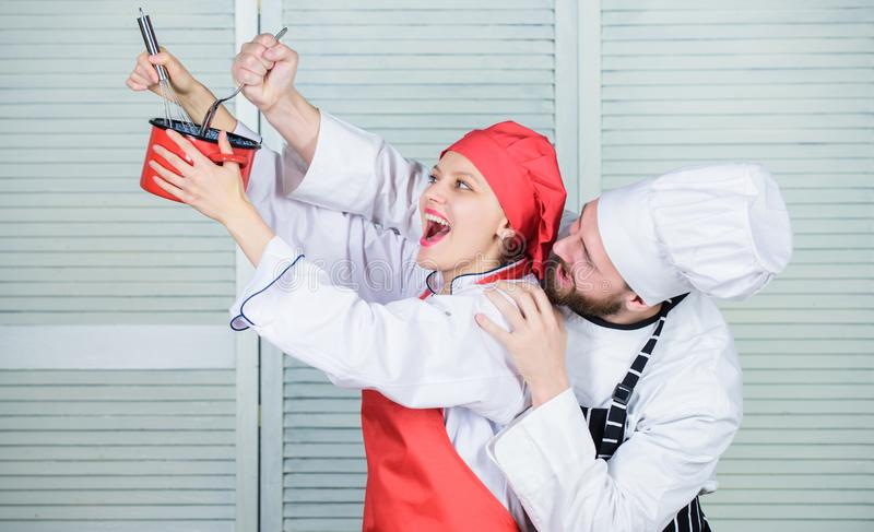 Baking pie together. Cooking together is more fun. Let my try taste. Couple having fun while whipping cream. Cooking. Healthy meal. Woman and bearded men chef royalty free stock images