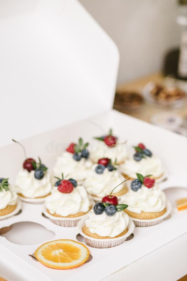 Baking set of cupcackes on table. Kids party royalty free stock photo