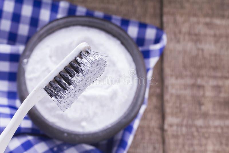 Baking soda and brush royalty free stock image