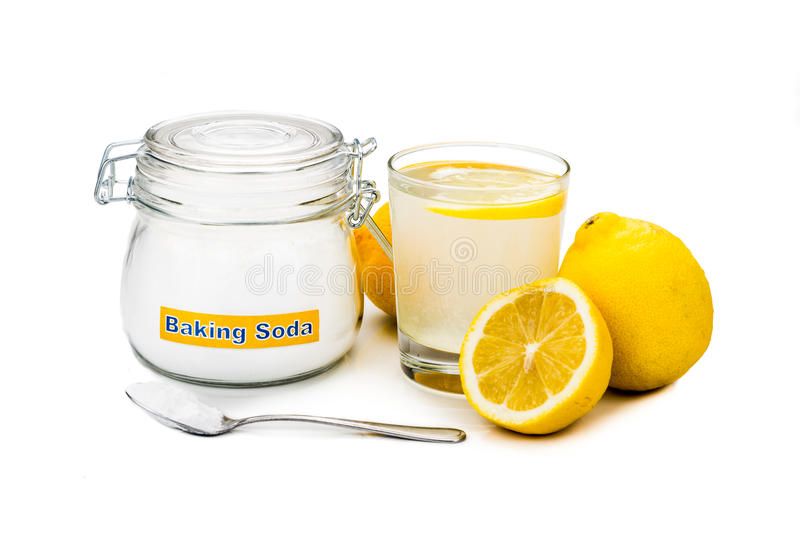 Baking soda with lemon juice in glass for multiple holistic usag. Es royalty free stock images