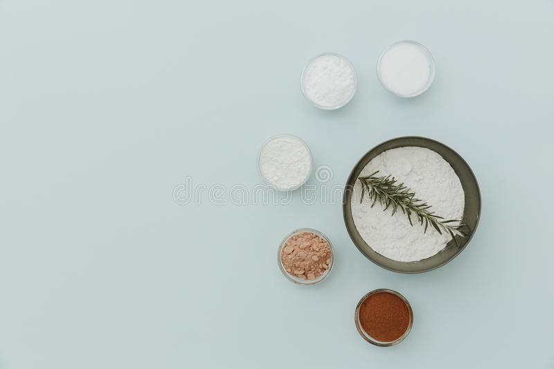 Baking soda, powder, sugar, flour, yeast on cup for baking on pastel background. Flat lay royalty free stock images