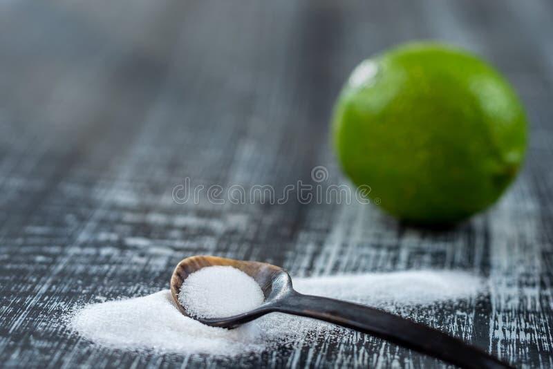 Baking soda - sodium bicarbonate and lemon. Natural, powder on a grey wooden background. Baking soda - sodium bicarbonate and lemon. Natural, powder grey wooen royalty free stock images