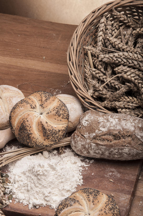 Baking theme with ambient light. Traditional rolls and bread in country theme royalty free stock images