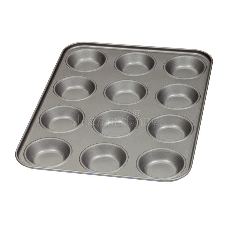Baking-tray. Muffin tin/ cupcake baking tray isolated on white stock photo