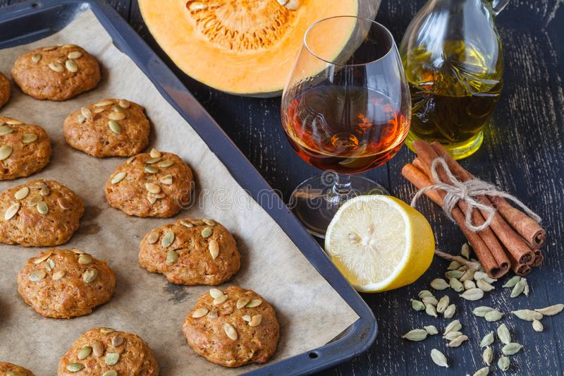 Baking tray with delicious oatmeal cookies on kitchen table stock photo