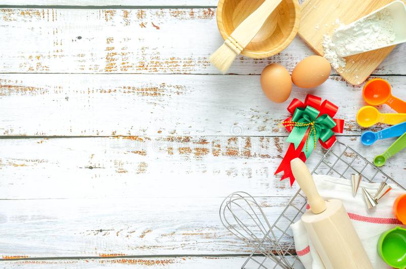Baking utensils and bakery cooking ingredients on white wooden background. Text space images, top view.  stock photography