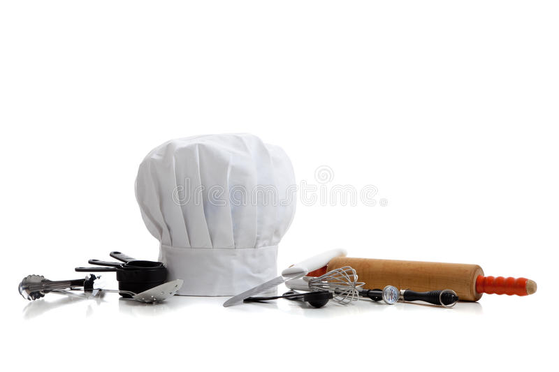 Baking utensils with a chef's hat stock photos