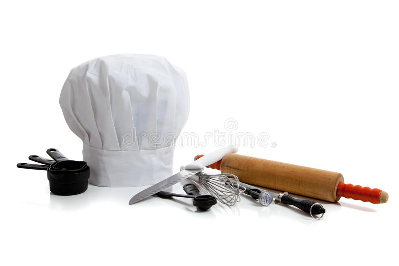 Baking utensils with a chef's hat. Several baking utensils with a chef's hat on white background