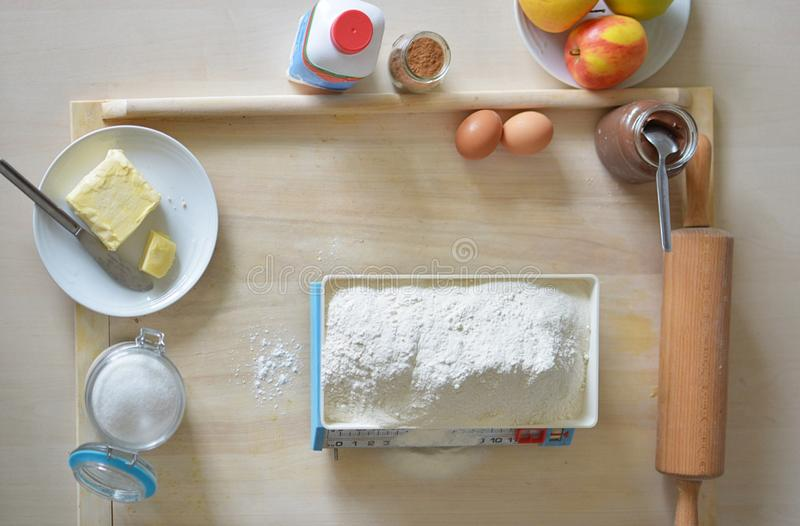 Baking yeast cake with cocoa filling 2 - weighing flour stock images
