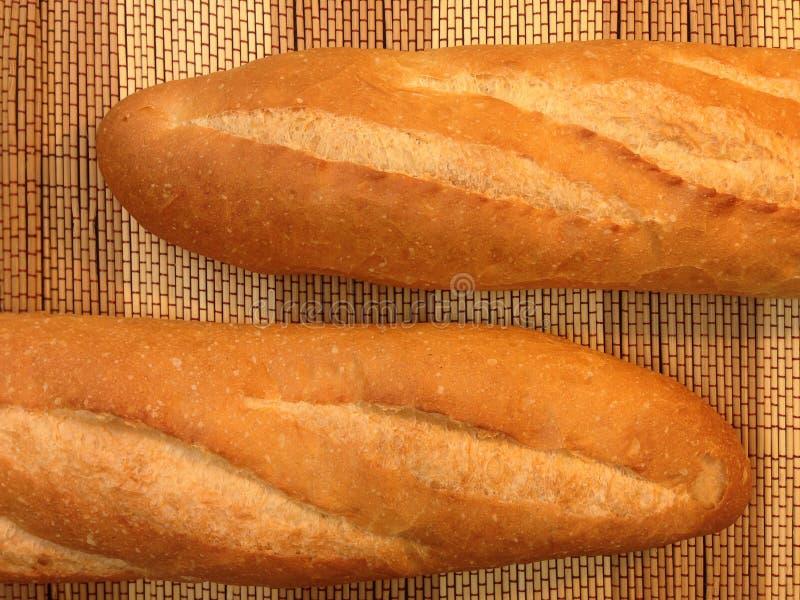 Bakkerijbrood van Baguette op een Houten Lijst stock afbeeldingen