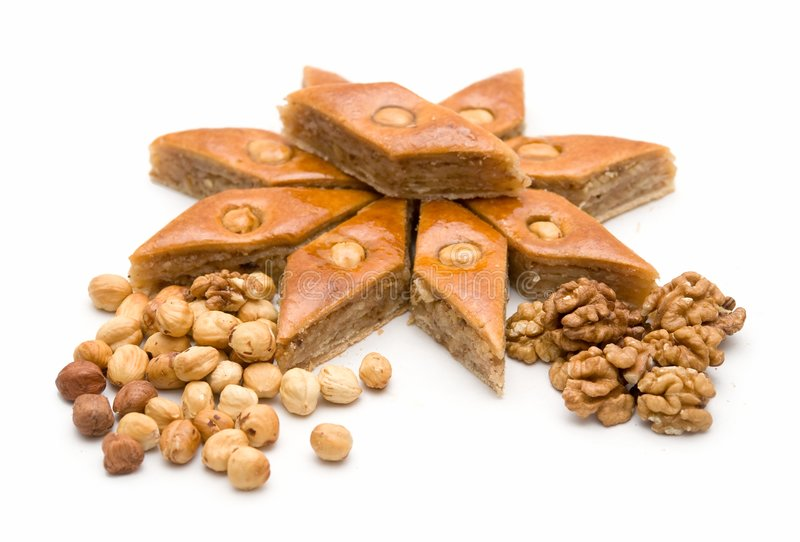 Baklava and nuts. East sweets on a white background royalty free stock image