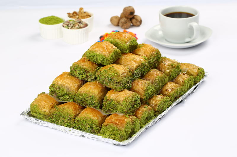 Baklava on plate. Turkish baklava on the plate and coffee on white background stock image