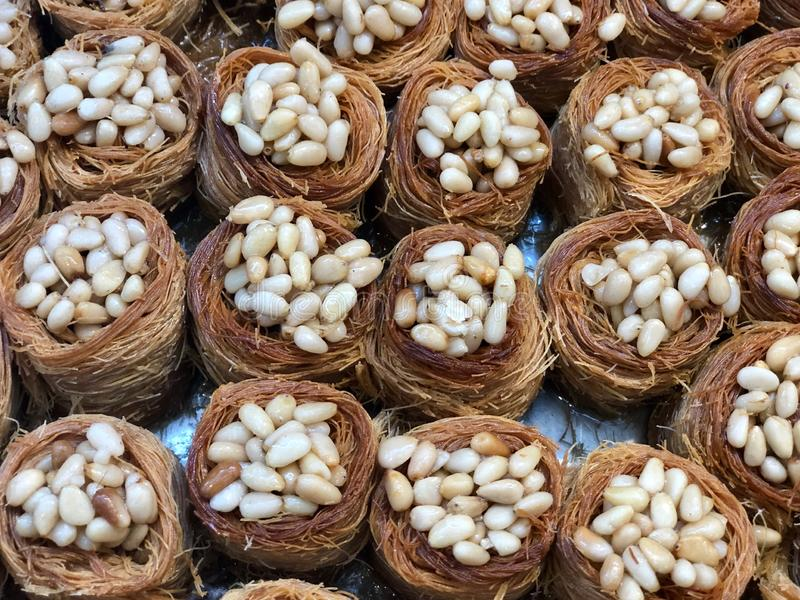Baklava Sweets. Traditional Arabic dessert . Pine nut Kadaif. Kadaif noodles are a type of thin Turkish noodles. They are made ​​of flour and stock photo