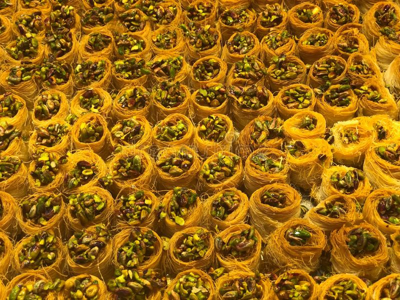 Baklava sweets. Traditional Arabic dessert . Pistachio Kadaif. Kadaif noodles are a type of thin Turkish noodles. They are made ​​of flour and stock photos