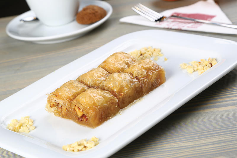 Baklava and tea. Turkish baklava on the plate and tea on white background royalty free stock photo