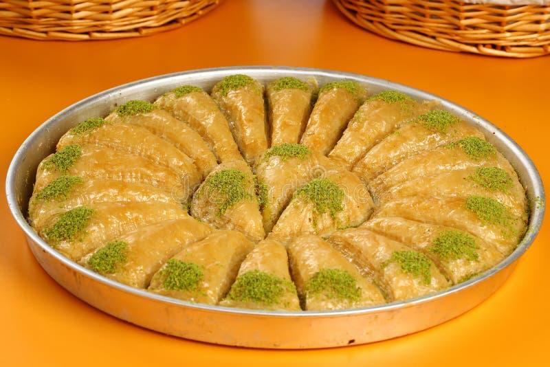 Baklava. Turkish baklava in the circle metal tray royalty free stock photo