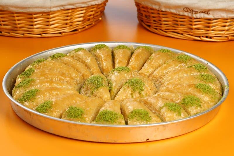 Baklava. Turkish baklava in the circle metal tray stock photography