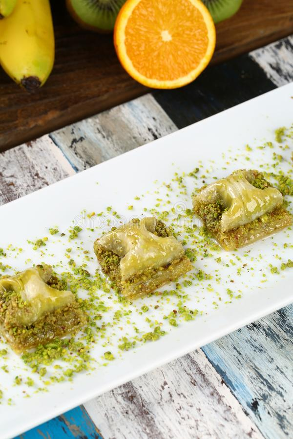 Baklava. Turkish baklava on the plate and beautiful background royalty free stock photography