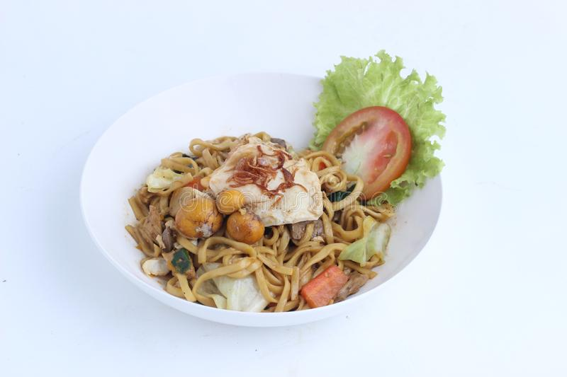 Bakmie Jawa, Indonesian Traditional Street Food Fried Noodle with uritan eggs. Isolated on white background stock photography