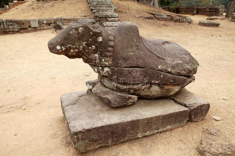 Bakong temple ruins. Nandi, the Shiva bull, in the enclosure of the Bakong temple ruins, Angkor, Siem Reap, Cambodia. The temple is part of the Roluos group stock images