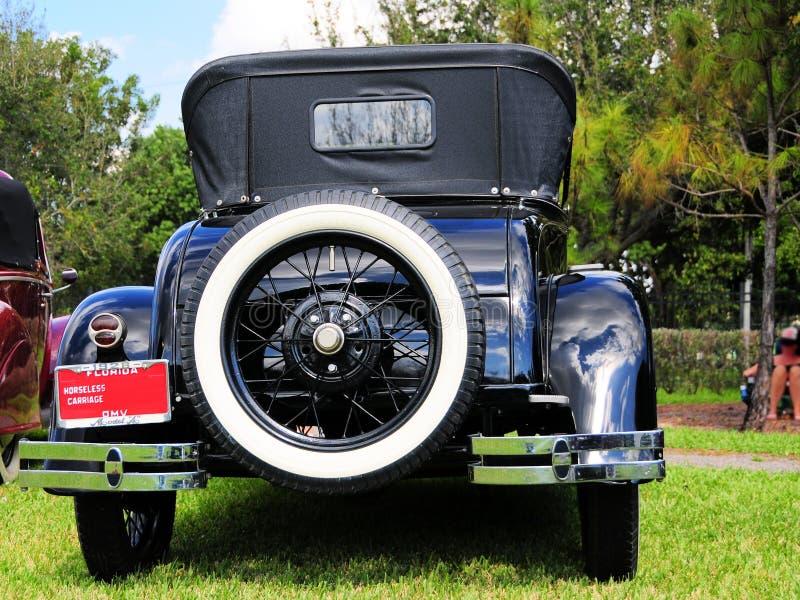 Bakre sikt av den horseless vagnen för 1928 Ford royaltyfri fotografi