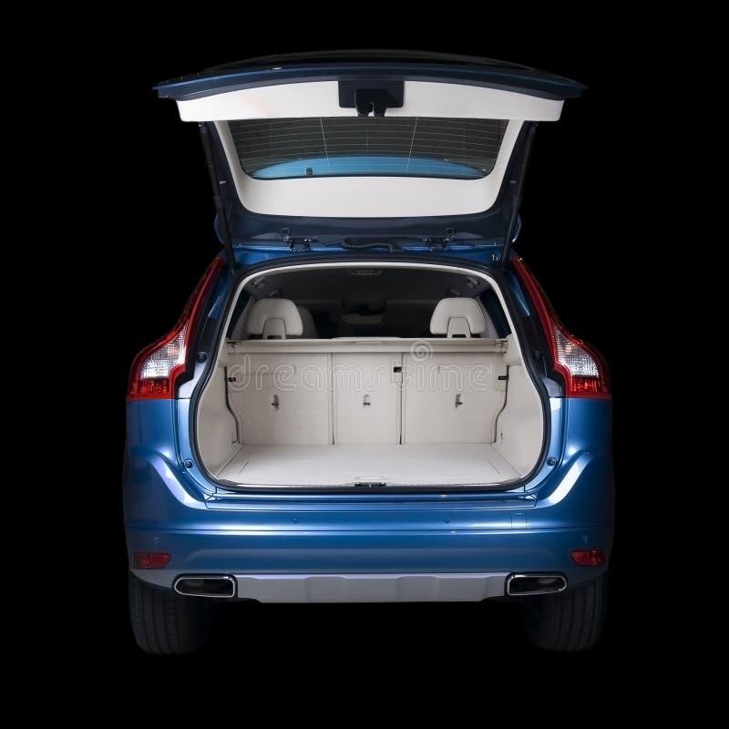 Bakre sikt av en blå bil arkivfoton