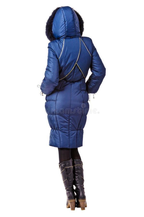 Bakre sikt av kvinnan i blått hooded lag för vinter arkivfoton