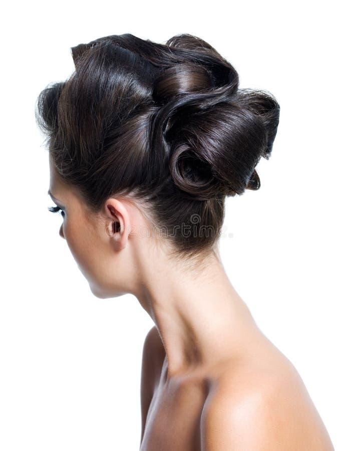 bakre sikt för lockig frisyr arkivfoto