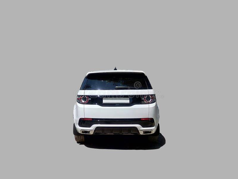 Bakre sikt för lyxig vit SUV bil fotografering för bildbyråer