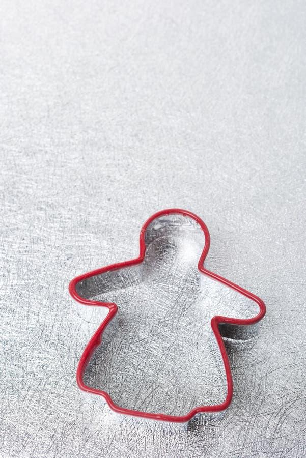 Bakselschotel in de vorm van de mens op een zilveren achtergrond royalty-vrije stock afbeelding