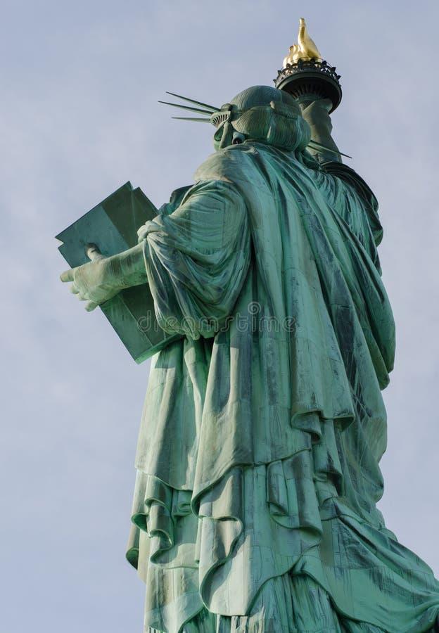 Baksida och sida av statyn av frihet fotografering för bildbyråer