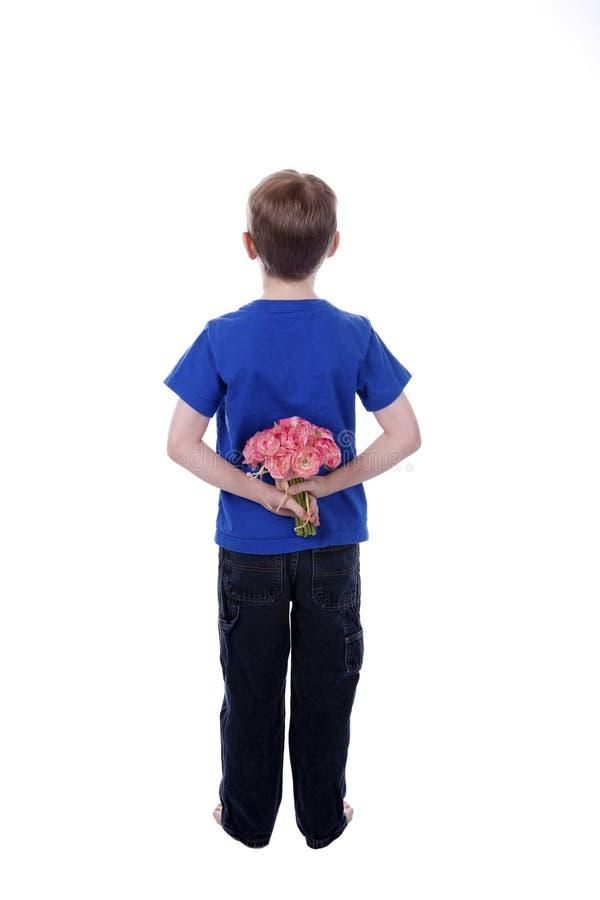 baksidt bak blommor arkivfoto