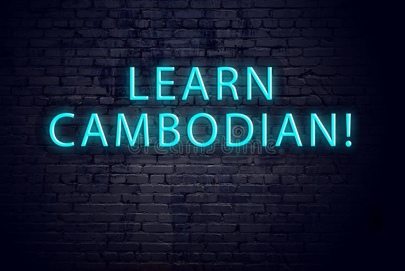 Bakstenen muur en neonteken met inschrijving Concept lerende cambodian royalty-vrije stock fotografie