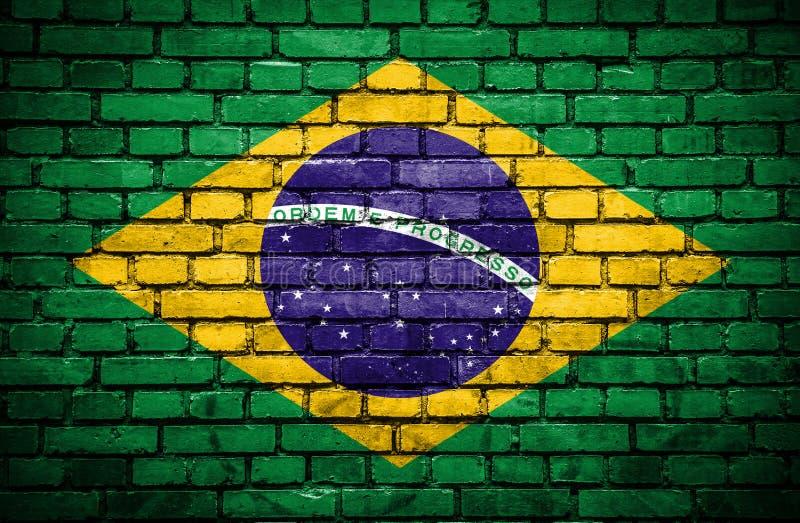 Bakstenen muur met geschilderde vlag van Brazilië stock illustratie