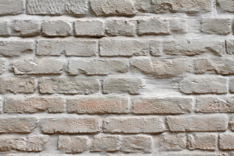 Bakstenen muur in pastelkleur wordt geschilderd die stock afbeelding