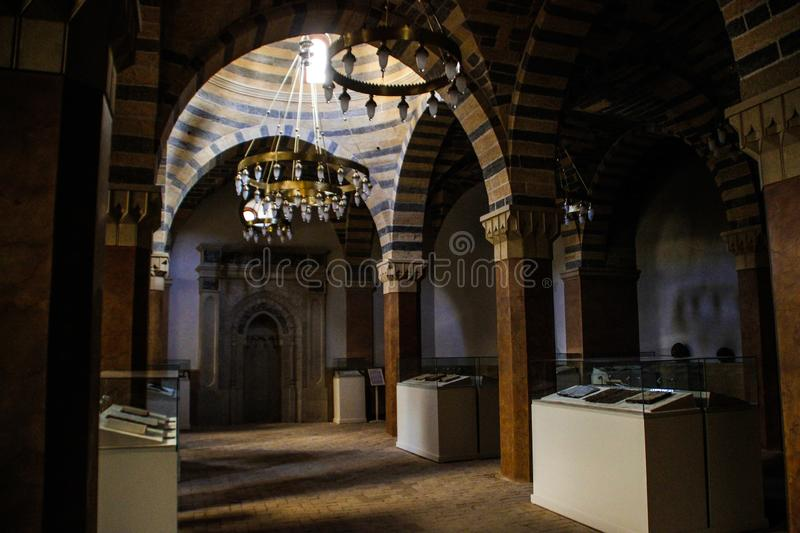 Inside the old mosque in the historic center of the old city. Colons and Quran stock image