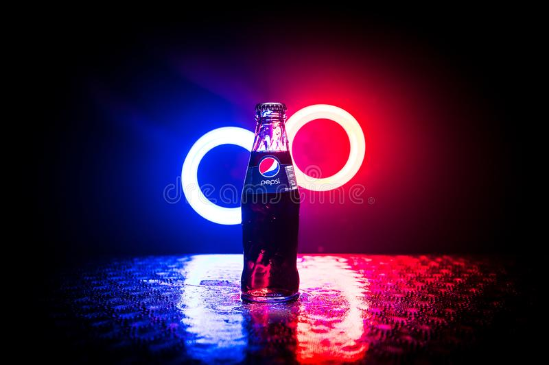 BAKU, AZERBAIJAN -APRIL 20,2019 : Pepsi Classic in a glass bottle against dark toned foggy background. Pepsi is a carbonated soft. Drink produced by PepsiCo stock images