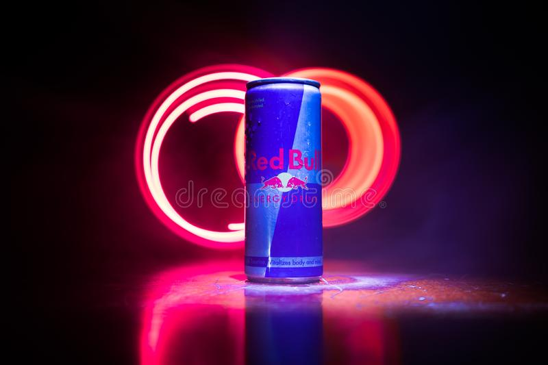 BAKU, AZERBAIJAN - April 20, 2018: Red Bull classic 250 ml can on dark toned foggy background. Red Bull is an energy drink sold by. Austrian company Red Bull stock photography