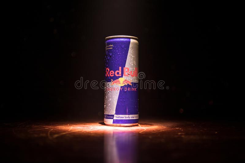 BAKU, AZERBAIJAN - April 20, 2018: Red Bull classic 250 ml can on dark toned foggy background. Red Bull is an energy drink sold by. Austrian company Red Bull stock photos