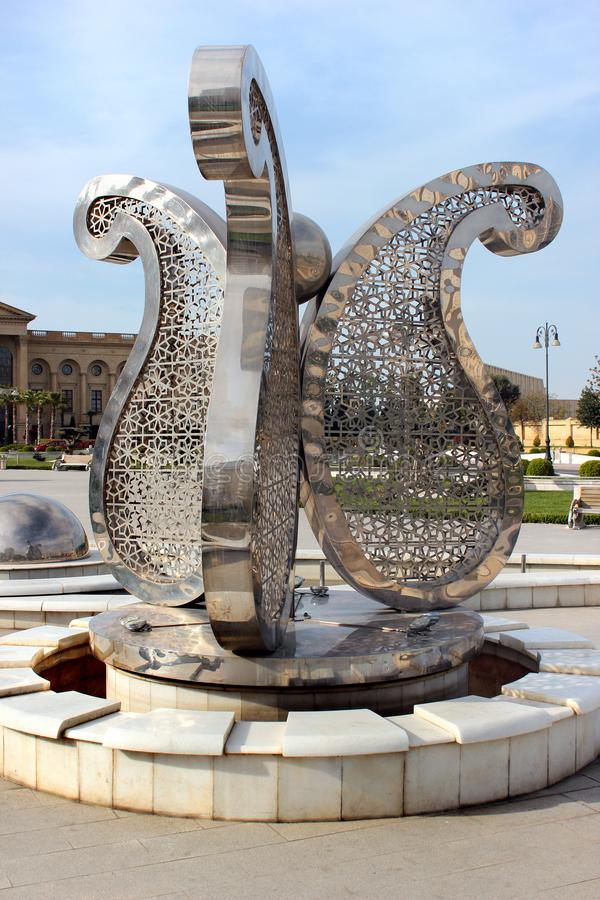 Street fountain with Buta motif in Baku, Azerbaijan. Baku, Azerbaijan - April 28, 2017: Street fountain with Buta Paisley, a droplet-shaped vegetable motif. It stock photos