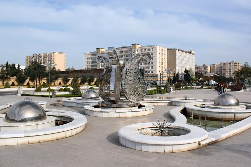Street fountain with Buta motif in Baku, Azerbaijan. Baku, Azerbaijan - April 28, 2017: Street fountain with Buta Paisley, a droplet-shaped vegetable motif. It royalty free stock photos