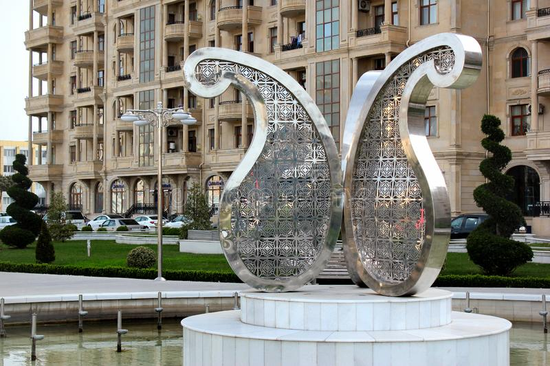 Street fountain with Buta motif in Baku, Azerbaijan. Baku, Azerbaijan - April 28, 2017: Street fountain with Buta Paisley, a droplet-shaped vegetable motif. It royalty free stock photography