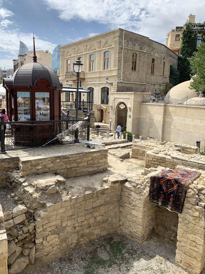 Baku, Azerbaijan, September, 09, 2019. Asaf Zeynalli street in the historic district of Icheri Sheher. The ancient Bath of Haji Ga royalty free stock photos