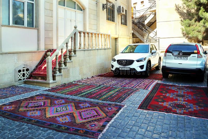 A car parked on a carpet for sale in the old town of Icheri Sheher. So demonstrate the quality of stock photo